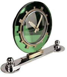 Very rare and large art deco clock manufactured during the 1930s, Very nice modernist, restrained design featuring a green mirrored and metal dial on a oval base toped by 2 chromed globes.