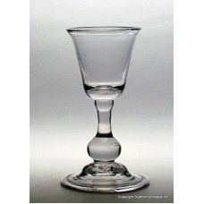 This is a superb Georgian Baluster Wine Glass which dates to 1715.  It has a Flared Buck Bowl over a very RARE True Baluster Knop Stem on a Domed and Folded Foot.   http://www.scottishantiquesinc.co.uk/georgian-glass/baluster-stem/truebaluster-knop#.U-22dEjLJOE