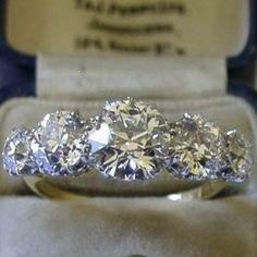 Would love this with 2 five-stone bands on either side- stones would be the same size as the smaller outside stones of this one Antique Platinum/18ct 3.75ct 5 stone diamond ring