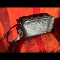 COACH dual zippered wristlet COACH double zippered wristlet.  One side has card slots.  Other sides just one large slot.  Fits iPhone 6.  Have used to carry pens and grocery list.  Great for running errands. Coach Bags Clutches & Wristlets