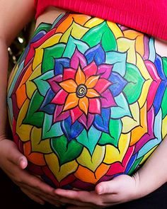 Love all the vibrant colors on this painted belly!