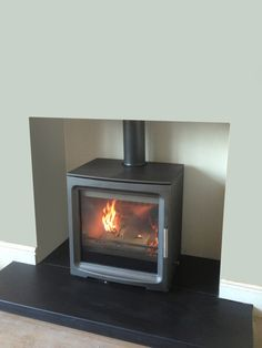 HETAS registered installer of wood burning and multi-fuel stoves, fireplace surrounds in the Stockport, Heaton Moor, Heaton Norris, Heaton Chapel and Manchester area Wood Stove Hearth, Slate Hearth, Wood Burner, Fireplace Tv Wall, Fireplace Surrounds, Fireplace Ideas, Log Burner Living Room, Tv Shelving, Stove Installation