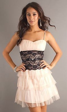 Short spaghetti strap dress that ties in back with sweetheart neckline and a layered skirt.