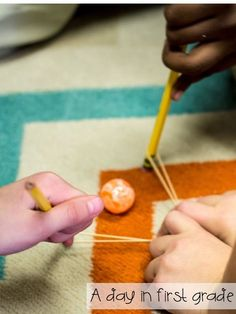 Kids work together in groups of three to see how far they can make their ball move without touching it, using only two pencils and a rubber band.  Great STEM activity!