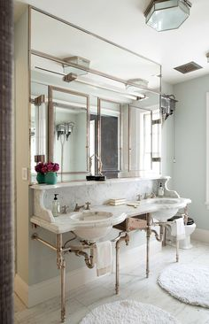 Love the polished nickel and soft grays hues of this stunning bathroom.