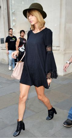 Taylor Swift adds a tinge of boho in a bell-sleeved mini dress + bowler hat + black ankle boots