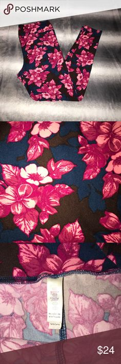LuLaRoe TC Bold Floral Pattern Leggings Gorgeous rich shades of navy black and pink in a floral pattern. Super stretchy and buttery soft. Excellent quality and condition. Check out my other listings to bundle and save! LuLaRoe Pants Leggings