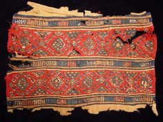 COPTIC TEXTILE. Egypt, Christian Period, c. 4th-6th century AD. Double-weave fabric with two registers of lozenge patterns on red ground. 8 x 12.5 inches.