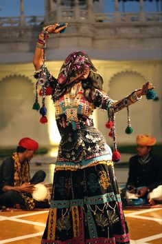 Taken at the Lake Palace Hotel in Udaipur, India, the woman is performing a traditional dance common to the Rajasthani region of India