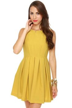"Wedding or art opening, cocktail party or graduation, you'll be prepared for any event in the Born Ready Mustard Yellow Dress. Fitted bodice is darted back and front, while crisp box pleats descend from waistband. Hidden side pockets and hidden back zipper. Fully lined. Model is wearing a small. Small measures 33"" shoulder to hem. 34"" bust. 26"" waist. Self: 100% Polyester. Cotton Lining. Machine Wash Warm. Imported."