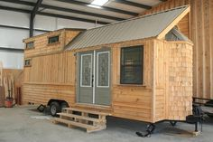 This 260 sq.ft. tiny house features custom cedar cabinets trimmed with black walnut, black walnut countertops, and rosewood flooring. Asking price: $65,000.
