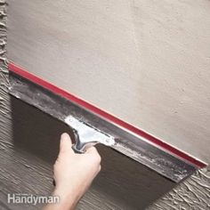 How to Skim Coat Walls - A new approach for smoothing rough walls that's easy to master. Smooth over rough or damaged walls with a skim coat of mud, applied with a special squeegee knife. It's easy to do and delivers great results. Drywall Mud, Drywall Repair, Drywall Finishing, How To Finish Drywall, Plaster Repair, Skim Coat Drywall, Skim Coat Plaster, Patching Drywall, Drywall Tape