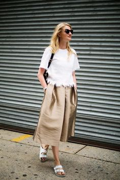 White t-shirt with frayed hem + gold midi skirt + white sandals