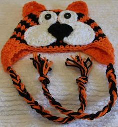 Crochet Tiger Earflap Hat Custom Size by mycrochetboutique on Etsy, $16.50  This adorable crochet tiger hat is crocheted with 100% cotton yarn in black, orange, and white. It can be made to fit size newborn to preteen. This is a custom order so please allow 3 days for item to be completed and shipped.