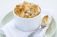 The whole family will love these individual corn and chicken pies with their flaky filo lids.