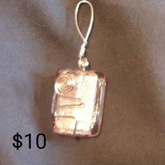 Square pink foil rectangle bead silver wire wrapped pendant.