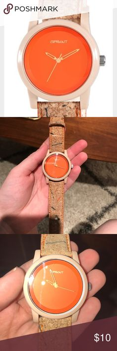 Sprout Watch 38mm round tan biodegradable corn resin case. Mineral crystal. Orange unmarked dial with Sprout logo at 12 o'clock. Orange skeleton hour and minute hands and stick second hand. Cork strap with orange stitching and sides. Tan corn resin buckle. Mercury-free battery. Japanese quartz movement. *battery needs to be replaced* Nordstrom Accessories Watches