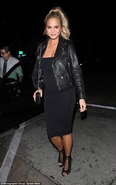 Chrissy Teigen wearing Saint Laurent Biker Jacket and Givenchy Bow Cut Shoulder Bag in Leather