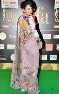 """""""Naannaku Prematho"""" heroine Rakul Preet Singh in pink net saree at IIFA Utsavam awards She was eye catchy in embroidery netted saree, designed by Sid Most Beautiful Bollywood Actress, Bollywood Actress Hot, Bollywood Fashion, Indian Bollywood, Rakul Preet Singh Saree, Saree Backless, Indian Actress Hot Pics, Indian Actresses, Sari Blouse Designs"""
