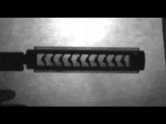 Slow motion x-ray of a bullet through a suppressor.