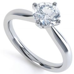 0.33cts G SI1 Solitaire Ring with Compass Setting. A classic four claw setting with a scintillating round brilliant cut diamond. 18ct white gold. Available for immediate delivery.