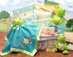 """Just Hoppin' Around Baby Hamper $ 84.99 Large ( Med. also available )  Cute little frogs for your prince or princess! This fabric lined baby storage hamper delivers the necessities and baby keepsakes! Includes: Baby Manicure Set,Baby Door Pillow, Baby Soap, Wash Cloths,Baby Beanie, Cotton T-Shirts,5x7 Frame, First Tooth and First Haircut Keepsake Boxes, Security Blanket embroidered with """" Little Prince"""" or """"Little Princess"""", soft frog rattle ring and 6 and 10 inch frog plush toys."""