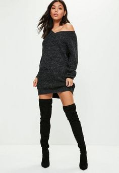A ribbed jumper dress with long sleeves, oversized fit and grey hue.