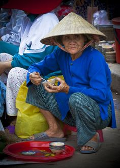 """""""My time"""" ~ A food stall operator finally has time to eat her own lunch after the rush hour. Hoi An Markets, Vietnam."""