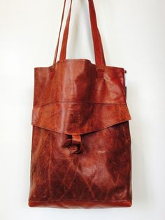 Lovely brown, aged tote. Made from recycled leather.  www.studiodoris.nl Sustainable bags and accessories.