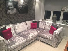 Silver crushed velvet couch in kitchen.