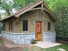 https://flic.kr/p/2z3WP8 | Dog House | Cedar siding, granite block base and shake roof shingles all give this new home a woodsey cottage setting in a lush wooded setting.