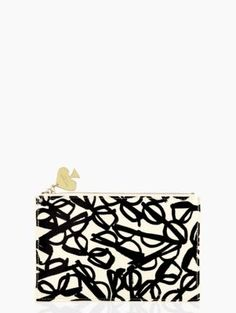 literary glasses pencil pouch set from kate spade new york, contains a ruler, 2 pencils, a pencil sharpener, and an eraser.