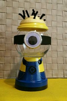 Minion Inspired Candy Jar by GCraftyHands on Etsy Clay Flower Pots, Flower Pot Crafts, Painted Flower Pots, Clay Pots, Tree Crafts, Clay Pot Projects, Clay Pot Crafts, Crafts To Make, Candy Bowl