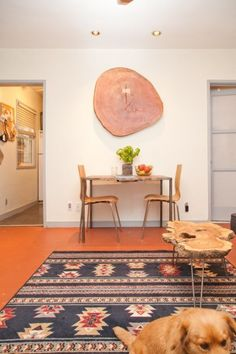 large wood slice wall art - that becomes an accent table! (via Apartment Therapy)