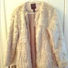 Fur Coat Very stylish fur coat worn only once for a costume, still has tags! Very comfortable and warm and stops mid thigh. Forever 21 Jackets & Coats
