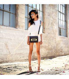 Lusttforlife is wearing: Lust For Life x Blaque Market romper, Sophie Hulme bag.