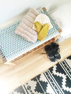 Winter Entry-Target-1-Design Crush -- bench is from target $100 -- blue yarn woven in by pinned -- wire basket and tribal rug?