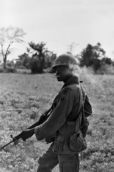 An infantryman in Vietnam - by Army photographer Charlie Haughey who served in Vietnam and packed away his photos in a shoebox for decades. Those images were recently pulled out and printed for display.