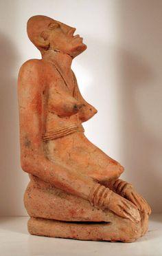Djenne sculpture of a kneeling woman, Mali, west Africa. ca. 13th-15th century, terracotta
