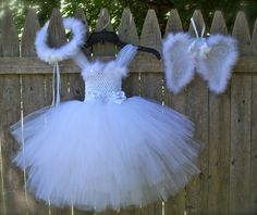 Hand made Angel Tutu Dress comes with wings and a halo fits size 2-3 years only one available, ready to ship.
