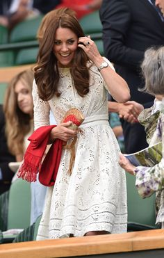 Kate looks amazing in this eyelet lace dress.