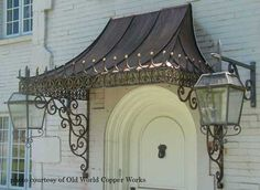 Photo of Potter Art Metal Studios - Dallas, TX, United States. Custom made, decorative antique copper awning with wrought iron scroll brackets. Awning Over Door, Porch Awning, Awning Canopy, Window Awnings, Door Canopy, Copper Awning, Metal Awning, Porches, Iron Pergola