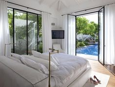 Levy:Chamizer Architects created this beautiful pool-side bedroom.