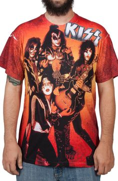 This KISS shirt shows Peter Criss, Ace Frehley, Gene Simmons and Paul Stanley posing on the front. The back of the shirt features the KISS logo along with the symbols for The Starchild, The Demon, The