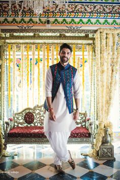 Groom Wear - White Kurta Pyjama with a Blue and Red Nehru Jacket | WedMeGood #wedmegood #indiangroom #indianwedding #groomwear #indiangroomwear #blue #nehrujacket