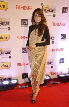 Diya Mirza rocks the new trend of wearing pants with a saree! We love how she tied it all together with a long sleeve blouse!