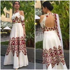 Bollywood Actor Karishma Kapoor Looking Gorgeous in White Printed Gown.