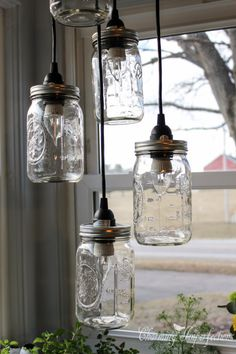 Mason jars can be used for so many things. But they make really pretty decor pieces and accents. Here are 10 beautiful mason jar decor ideas that you will most definitely fall in love with. Mason Jar Chandelier, Mason Jar Lighting, Kitchen Lighting, Mason Jar Projects, Mason Jar Crafts, Decorated Jars, Jar Lights, Light Project, Rustic Lighting