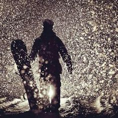 this is such a simply but beautiful image. The silhouette with the bright light coming from behind, brings out the falling snow, and almost give you the chills.