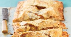 "These ""pie bars"" feature apple pie filling enclosed in flaky, butter pastry - traditional pie in an non-traditional form."